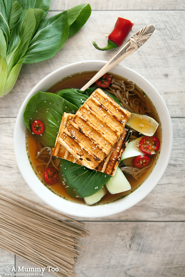 Grilled tofu, bok choy, red chilli and noodles feature in this vegan soba noodle soup