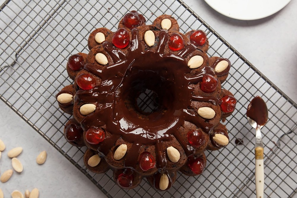 Decorating the Tropical fruit cake with cherries and almonds