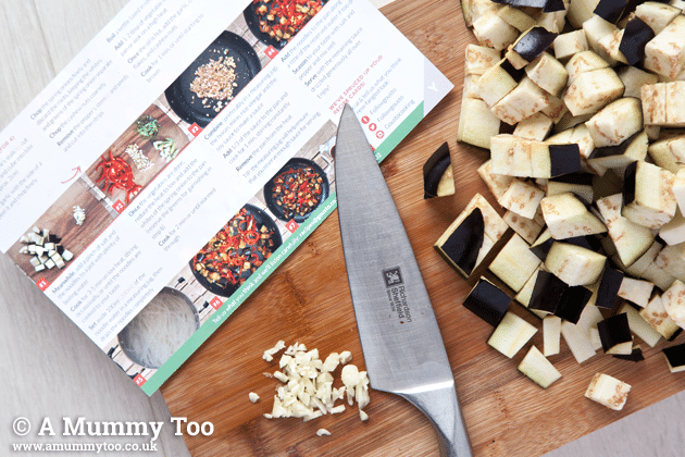 The recipe card from Gousto on a chopping board