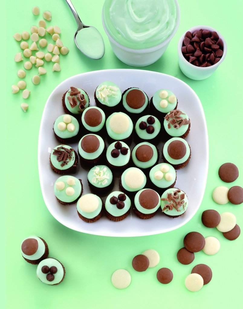 These sweet mini mint choc chip cupcakes are topped with a minty icing and chocolate decorations.