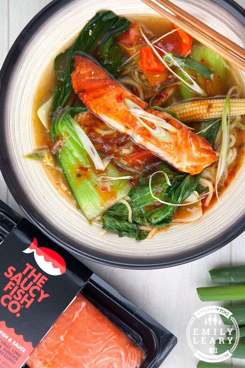 Close up of spicy salmon noodle soup. made with The Saucy Fish Co Salmon with Chilli, Lime and Ginger dressing, grilled and placed on a bed of sesame, ginger and garlic noodle soup, packed with stir-fried green veg.