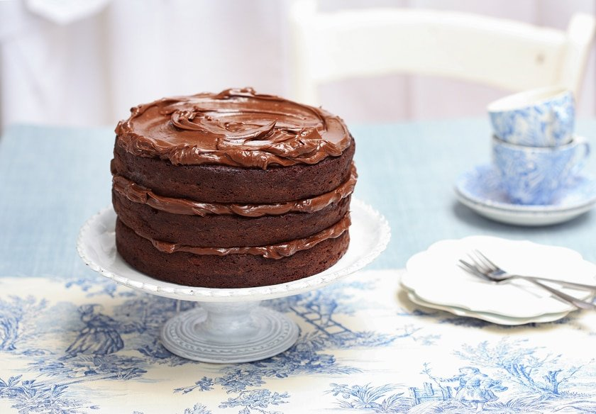 YUM! A gorgeous, decadent triple layer chocolate fudge cake from scratch. Here's how to make this chocolate layer fudge cake.