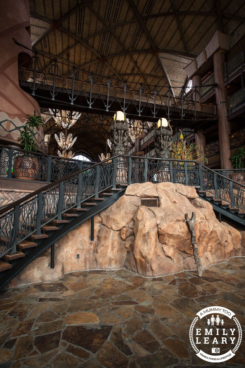 side angle shot of the lobby of Animal Kingdom Lodge Disney World Florida with a mummy too logo in the lower-right corner