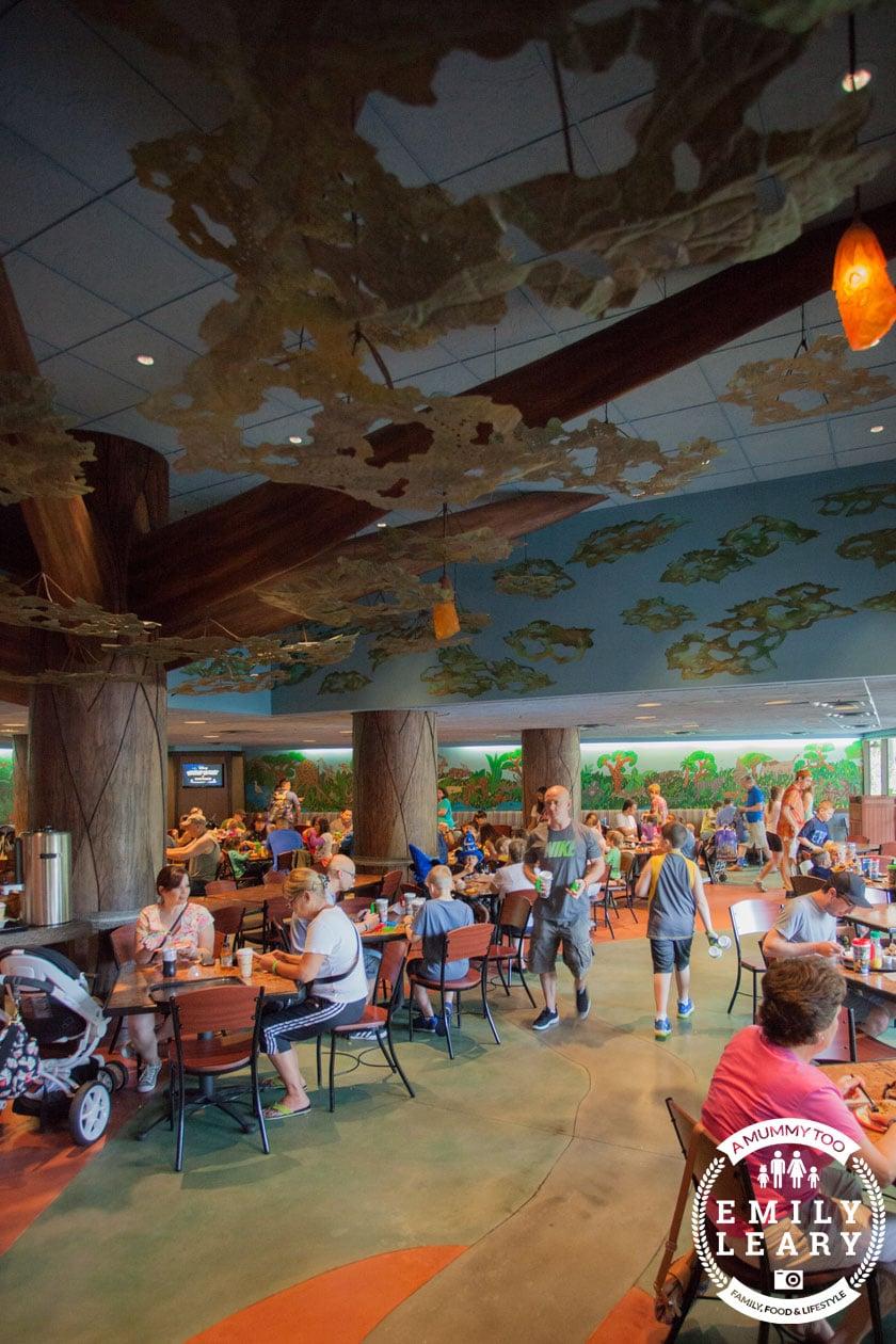 Inside Disney World Mara restaurant in Animal Kingdom Lodge with a mummy too logo in the lower-right corner