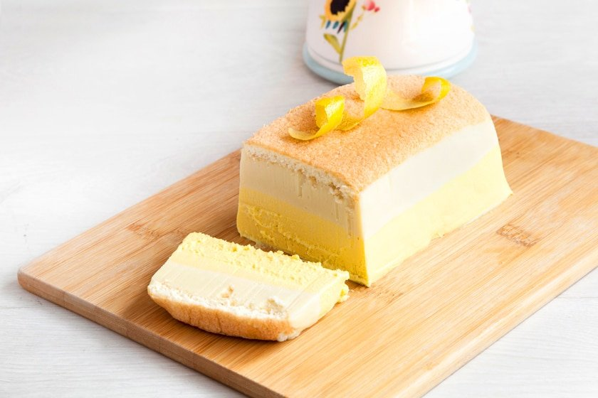 Layered limoncello cheesecake - made with a light sponge, ricotta, white chocolate and a hit limoncello that is guaranteed to have you coming back for seconds...and thirds.