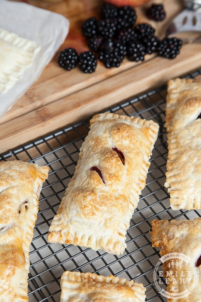 These are perfect for an afternoon cooking with kids. Little puff pastry parcels, filled with apples and blackberries.