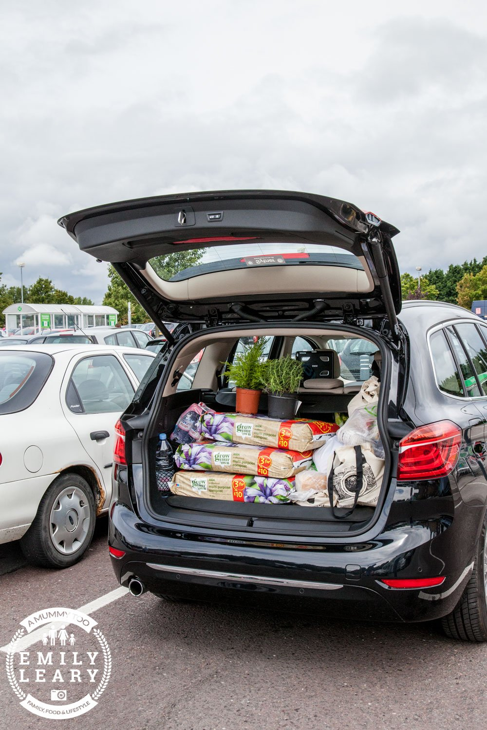BMW 2 Series Gran Tourer packed at supermarket (boot)