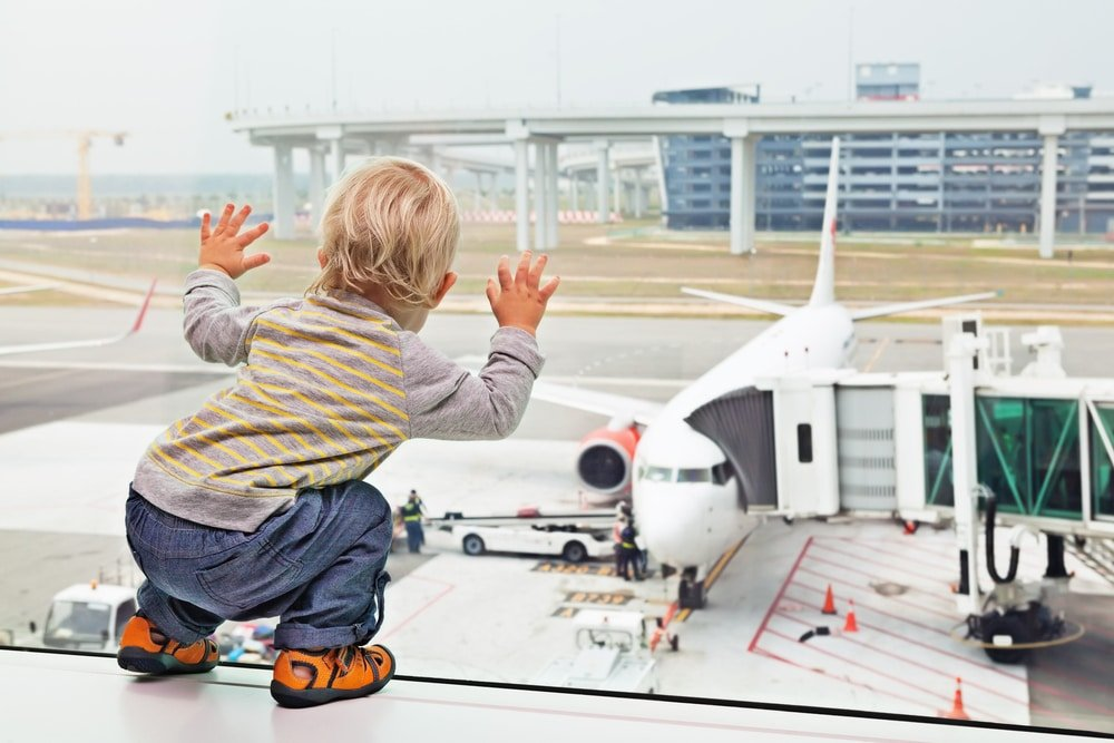 child watching planes