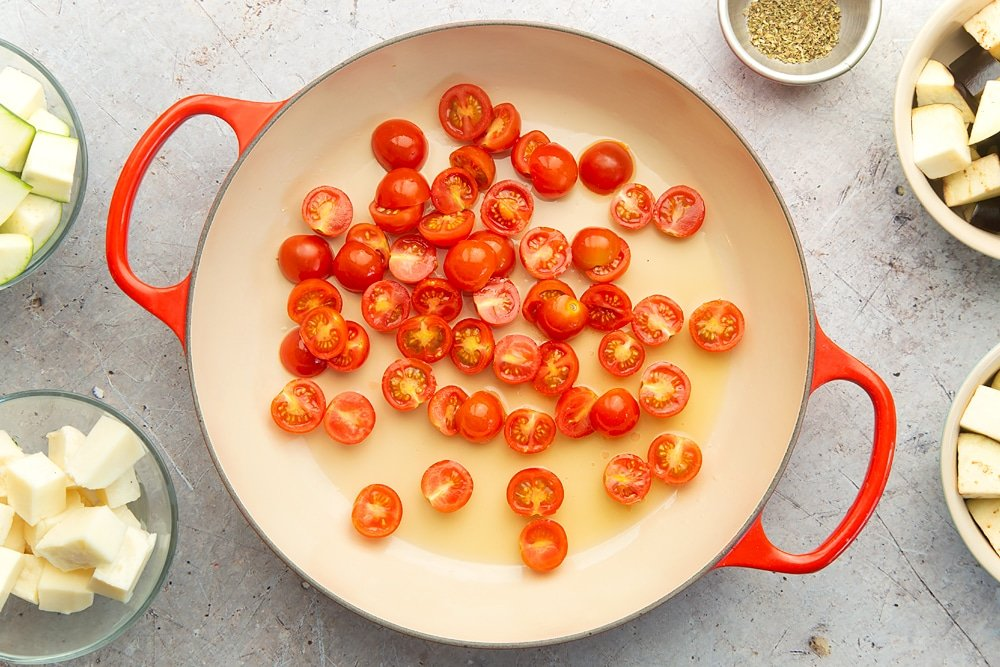 Frying cherry tomatoes in a pan