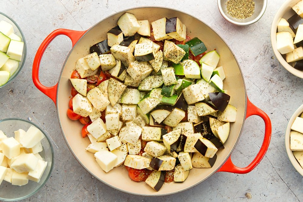 Aubergine, courgette, halloumi and herbs are added to the frying pan