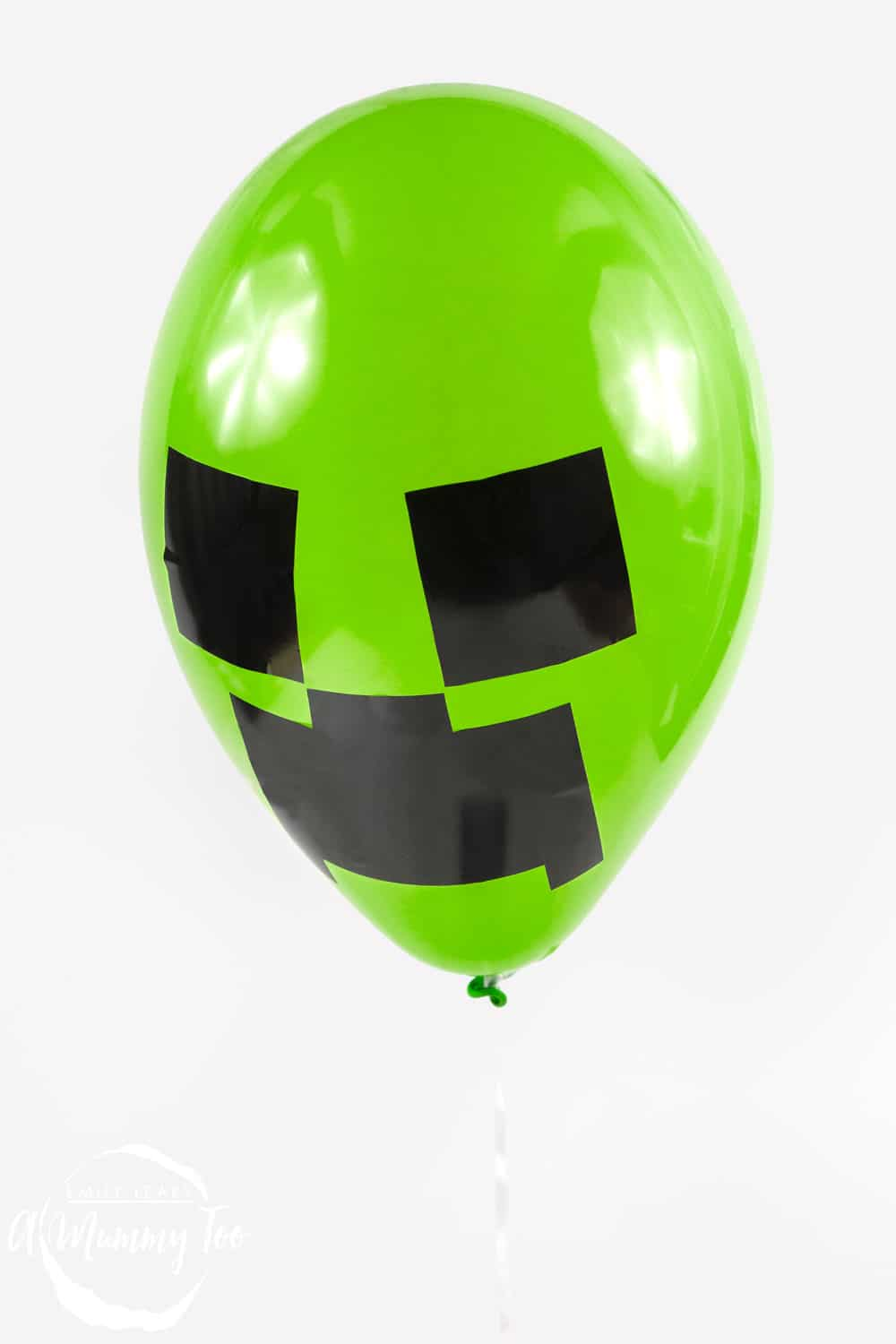 Front angle shot of a green Creeper minecraft balloon with amummytoo logo in the lower-left corner