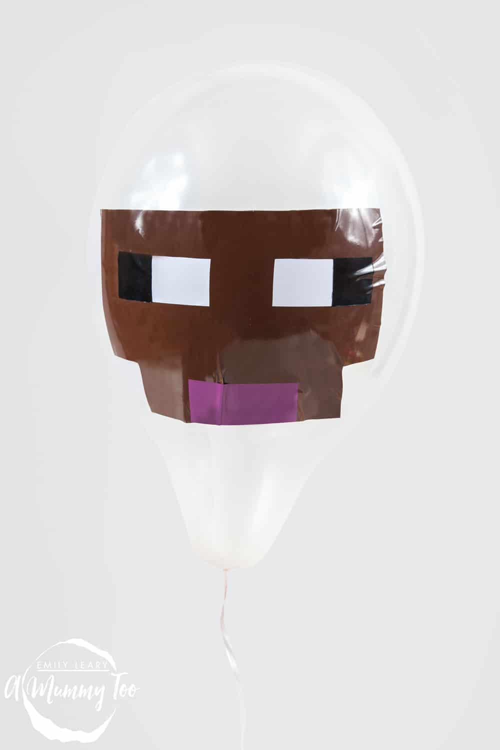 Front angle shot of a white Sheep minecraft balloon with amummytoo logo in the lower-left corner