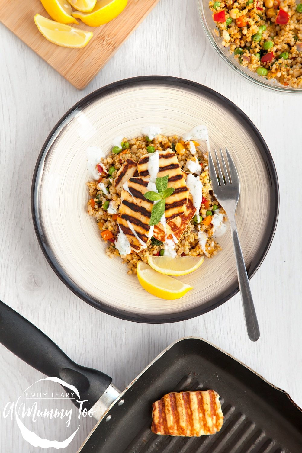 Vegetable rich couscous topped with dry-fried halloumi and drizzled with a zesty mint yoghurt dressing.