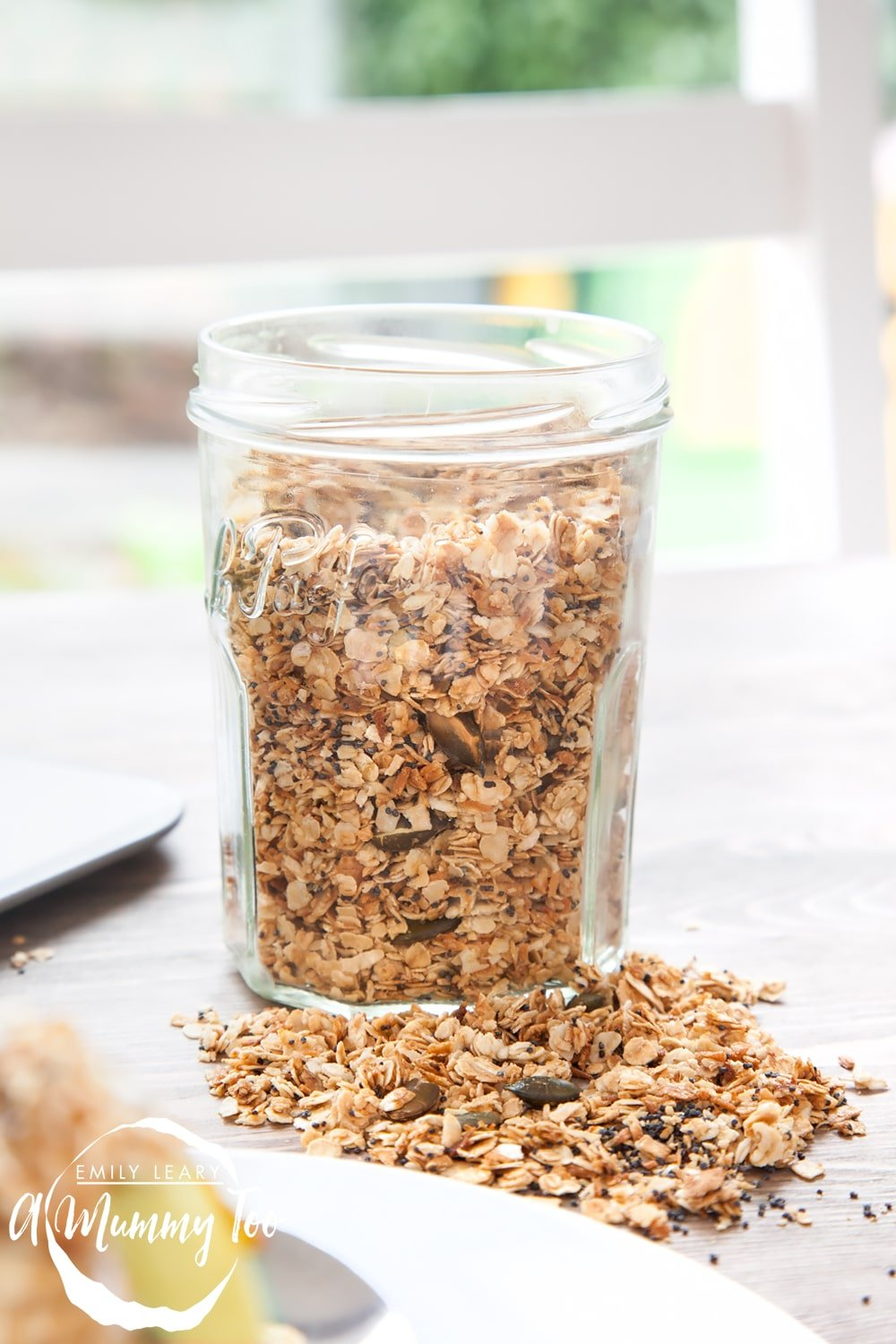 Granola stored in a jar, ready to use in a future recipe
