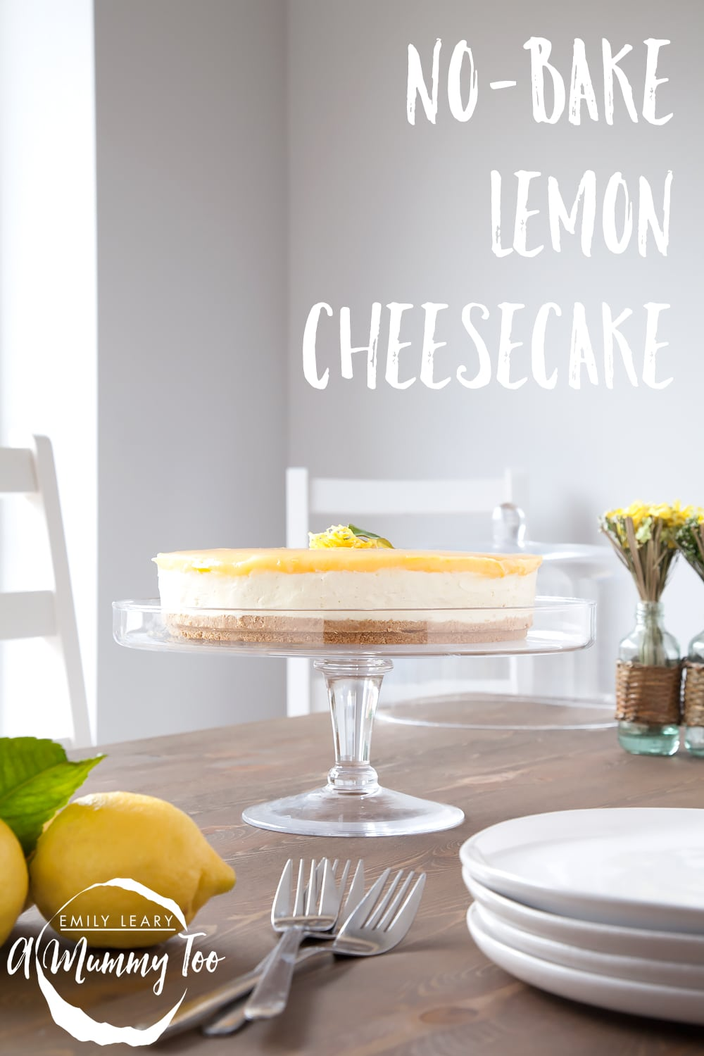 No-bake lemon curd and white chocolate cheesecake on a stand. A caption reads: no-bake lemon cheescake.
