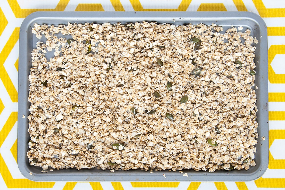 Raw granola mix on a baking tray