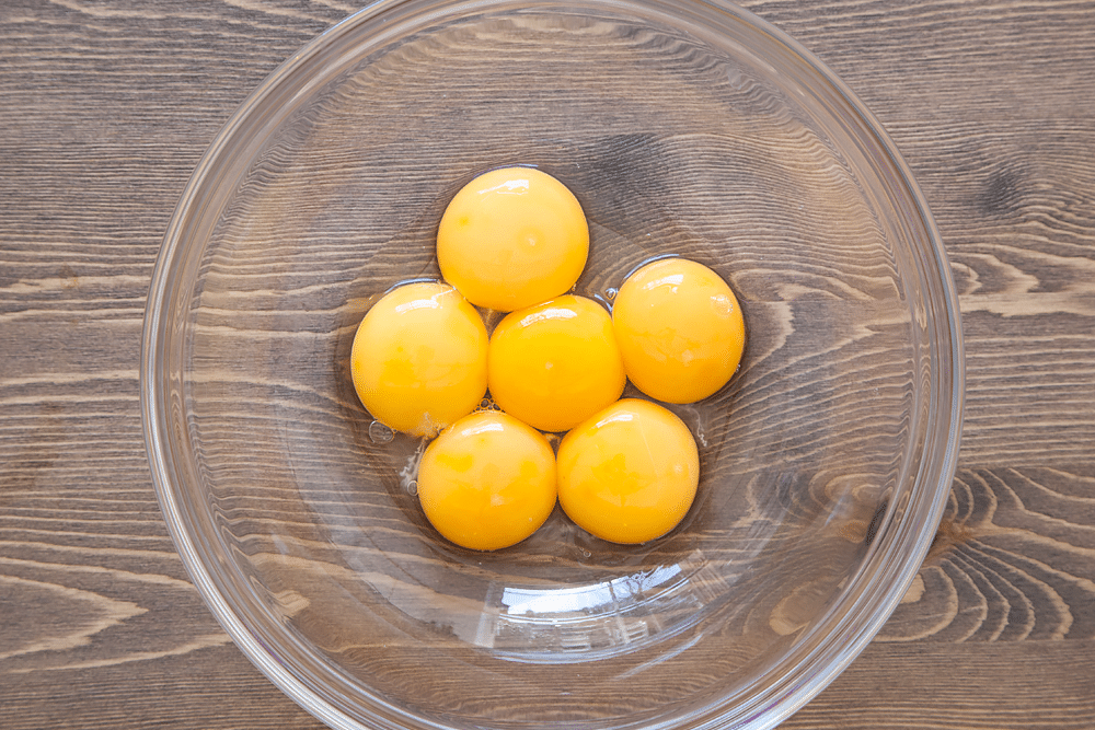 Egg yolks in a glass bowl