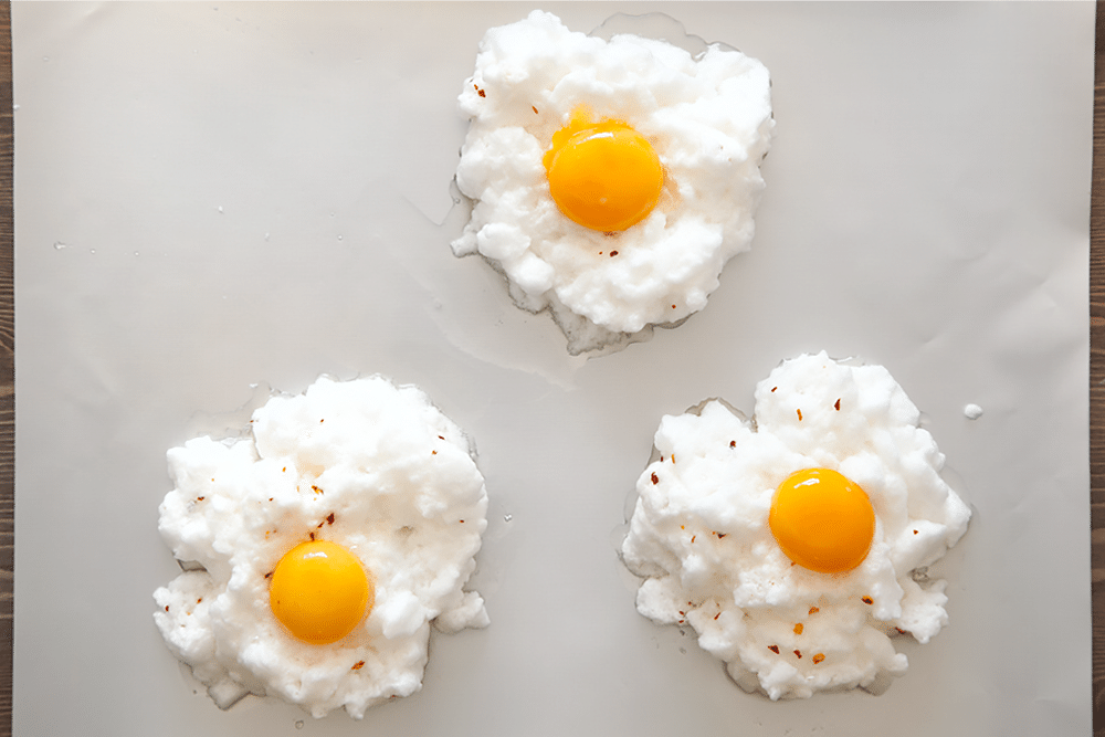 Spicy egg clouds topped with an egg yolk to create spicy eggs in clouds