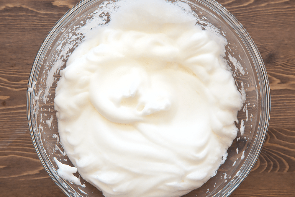 Whisked egg whites in a bowl