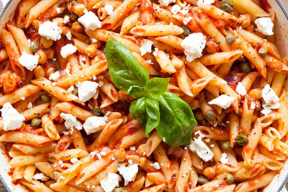 Top your zingy spring pasta with crumbled feta