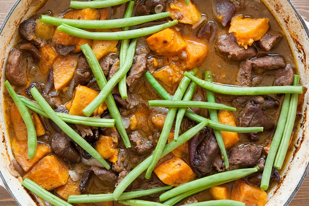 Add green beans to the slow cooked lamb and sweet potato casserole