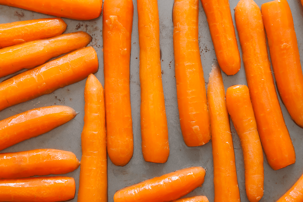 Sliced carrots on a baking tray