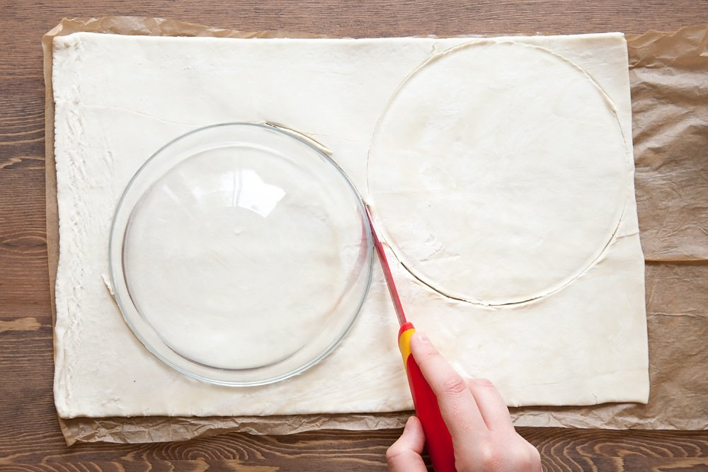 Cut your pastry into circles to form your tart base, using a glass bowl as a guide