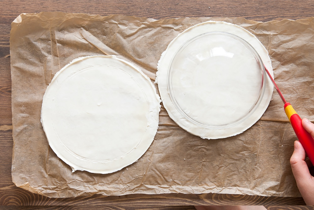 Score a smaller circle inside your tart base, using a smaller bowl as a guide
