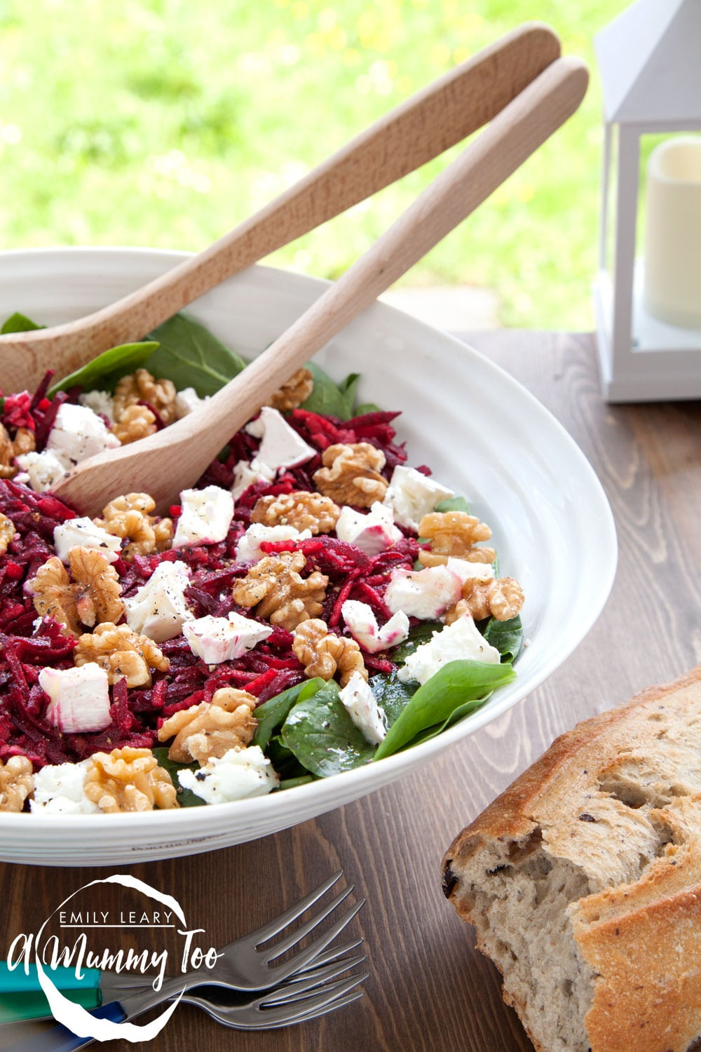 A bramley apple and beetroot salad, topped with goat's cheese and walnuts