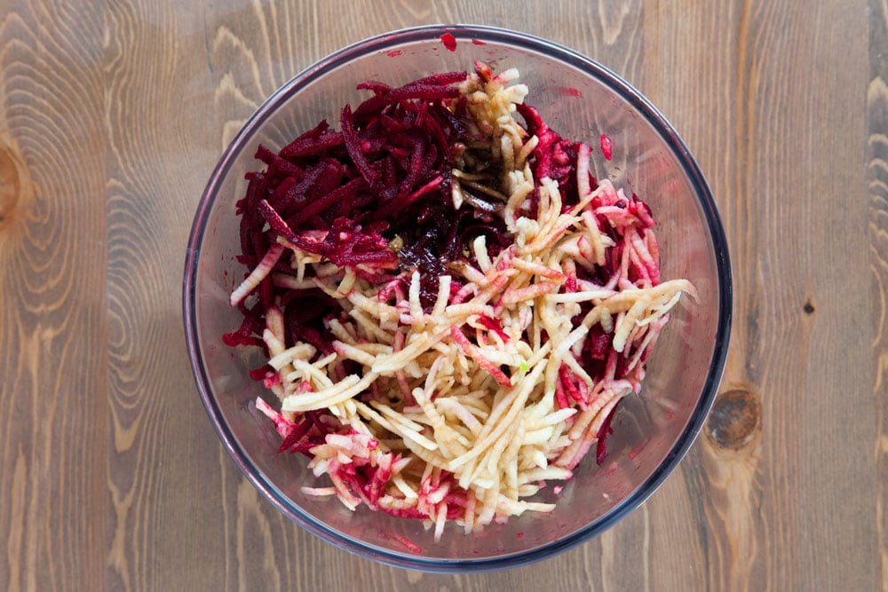 Grated bramley apples and beetroot in a bowl