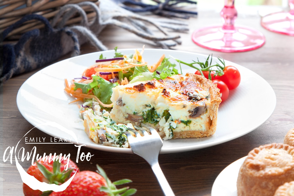 Freshly baked mushroom, spinach and feta quiche, served with a side salad