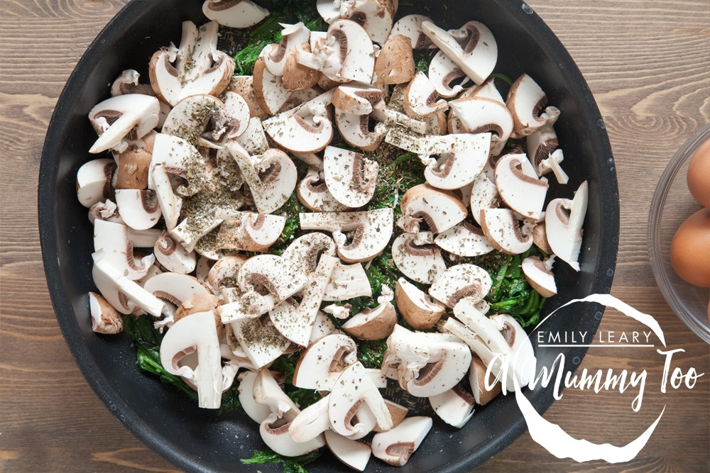 Sliced chestnut mushrooms are added to the pan