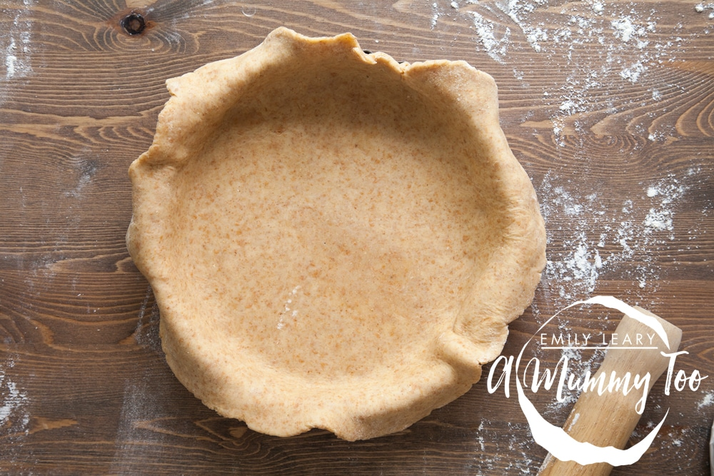 Creating the quiche using pastry and a quiche tin
