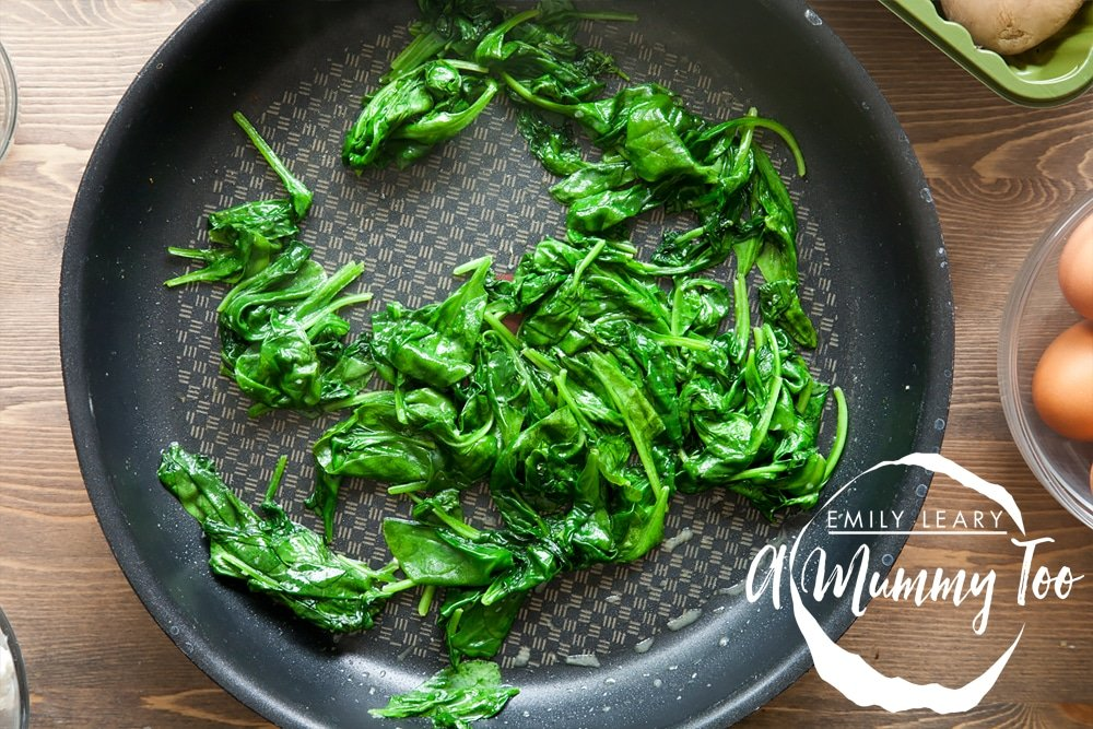 Frying spinach until gently wilted