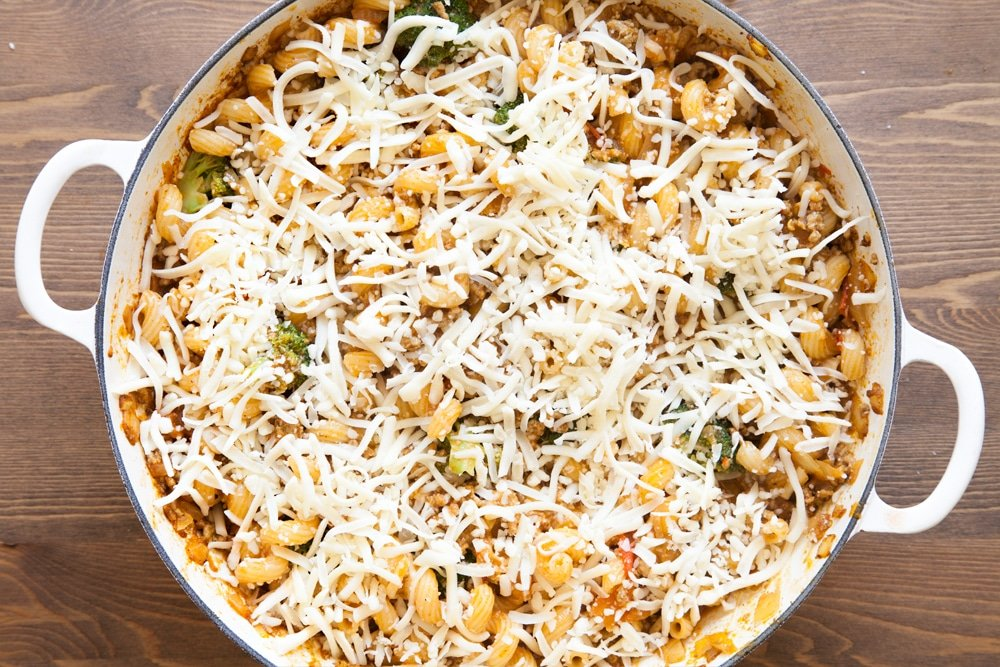 Sprinkle the chunky keema pasta bake with cheese before baking