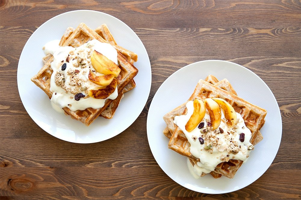 Garnished granola waffles with coconut fried apples