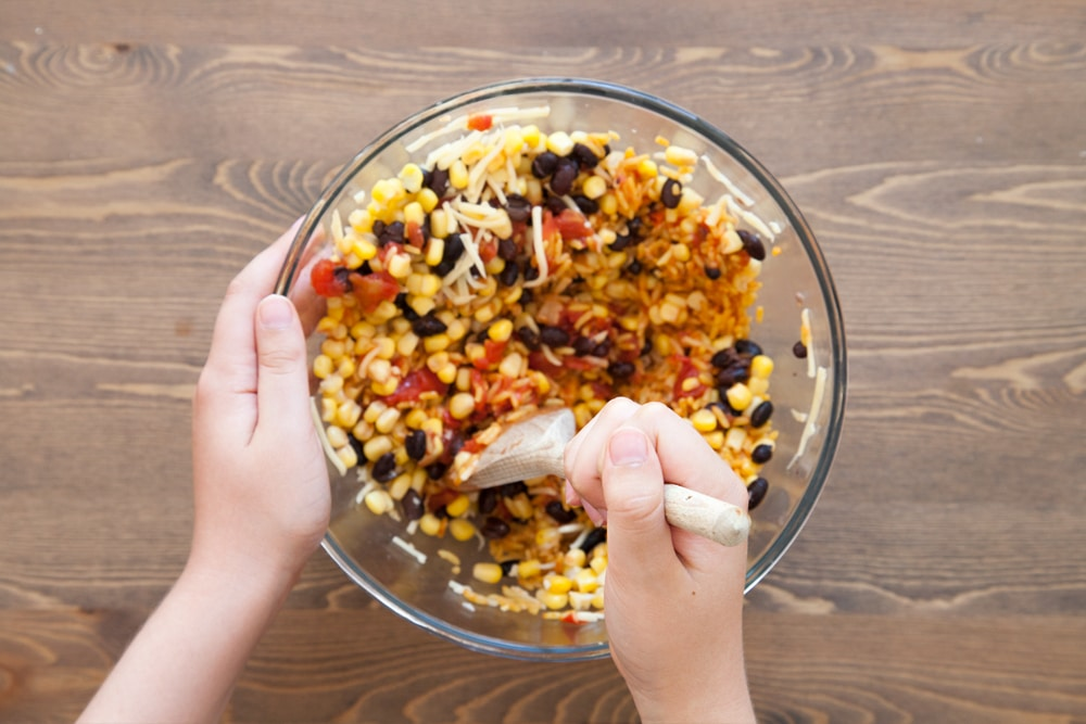 Children can help stir the taco filling