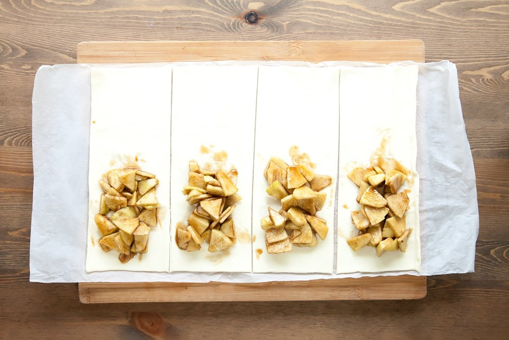 Assembling the apple and granola puff parcels