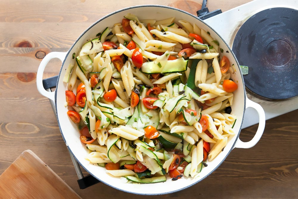 Adding the pasta to the pan