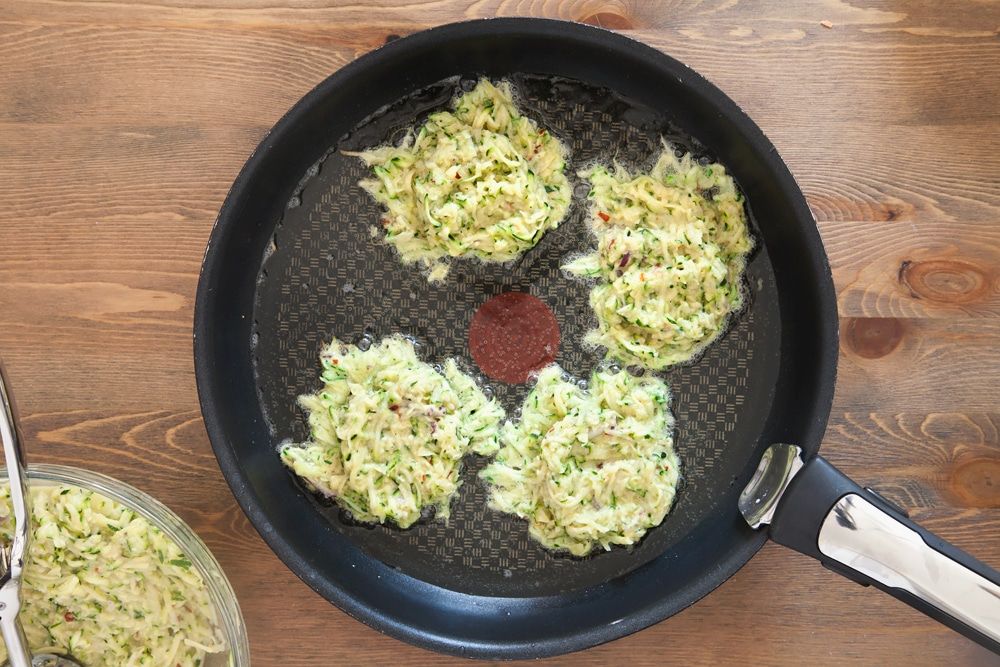 Spoon the courgette latke mix into a frying pan
