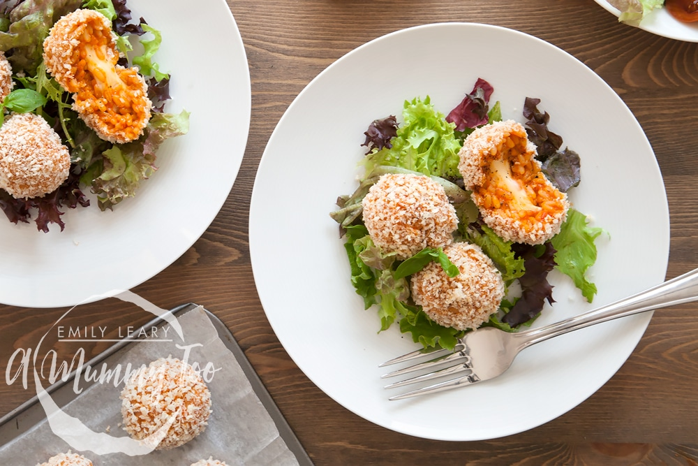 Serve these tomato risotto balls with a smoked cheese centre warm with salad and enjoy!