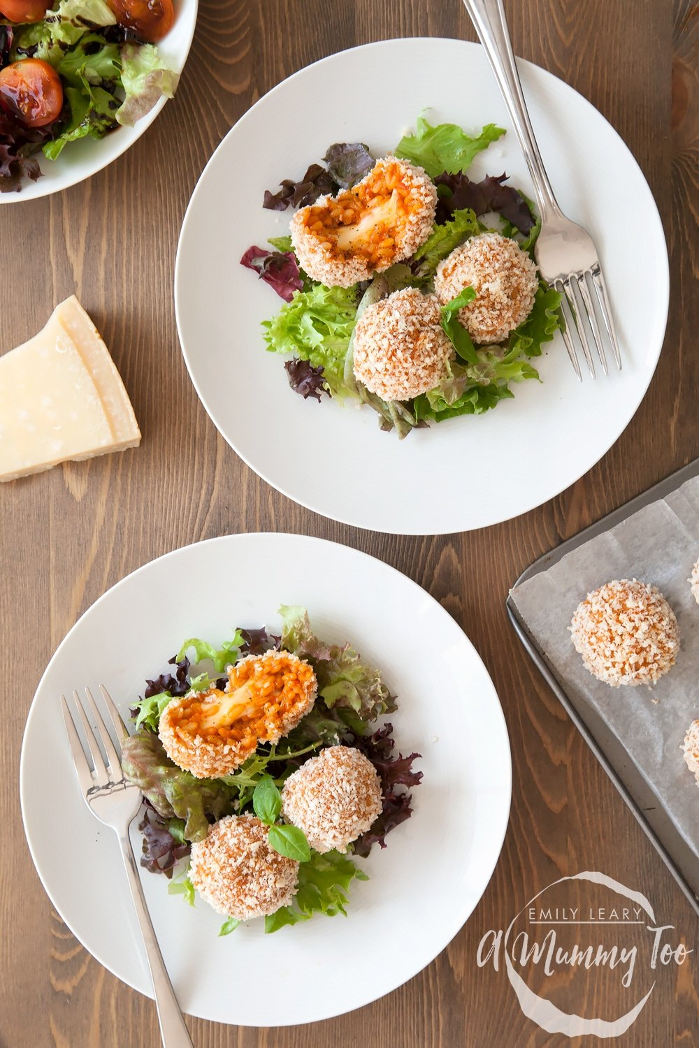 Easy tomato risotto balls with a smoked cheese centre, served with salad