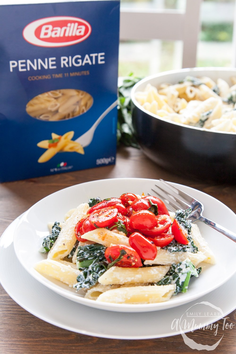 The completed cavolo nero recipe with a box Barilla penne rigate pasta used to create the recipe.