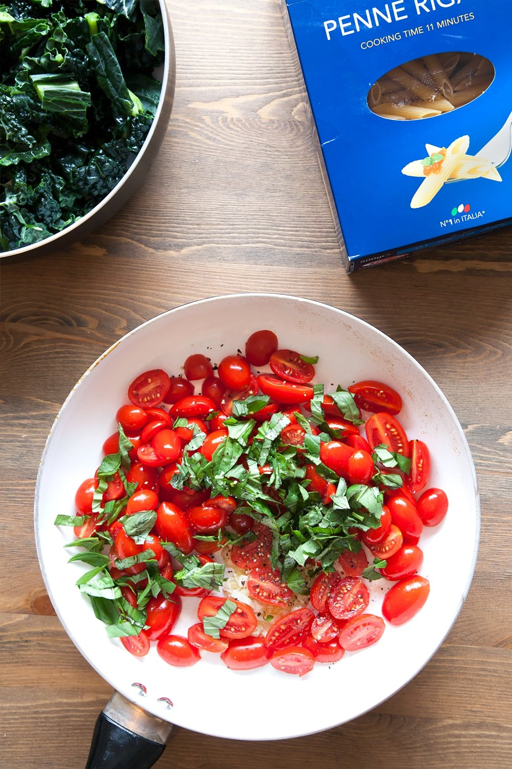 Preparing the tomatoes and basil in a frying pan