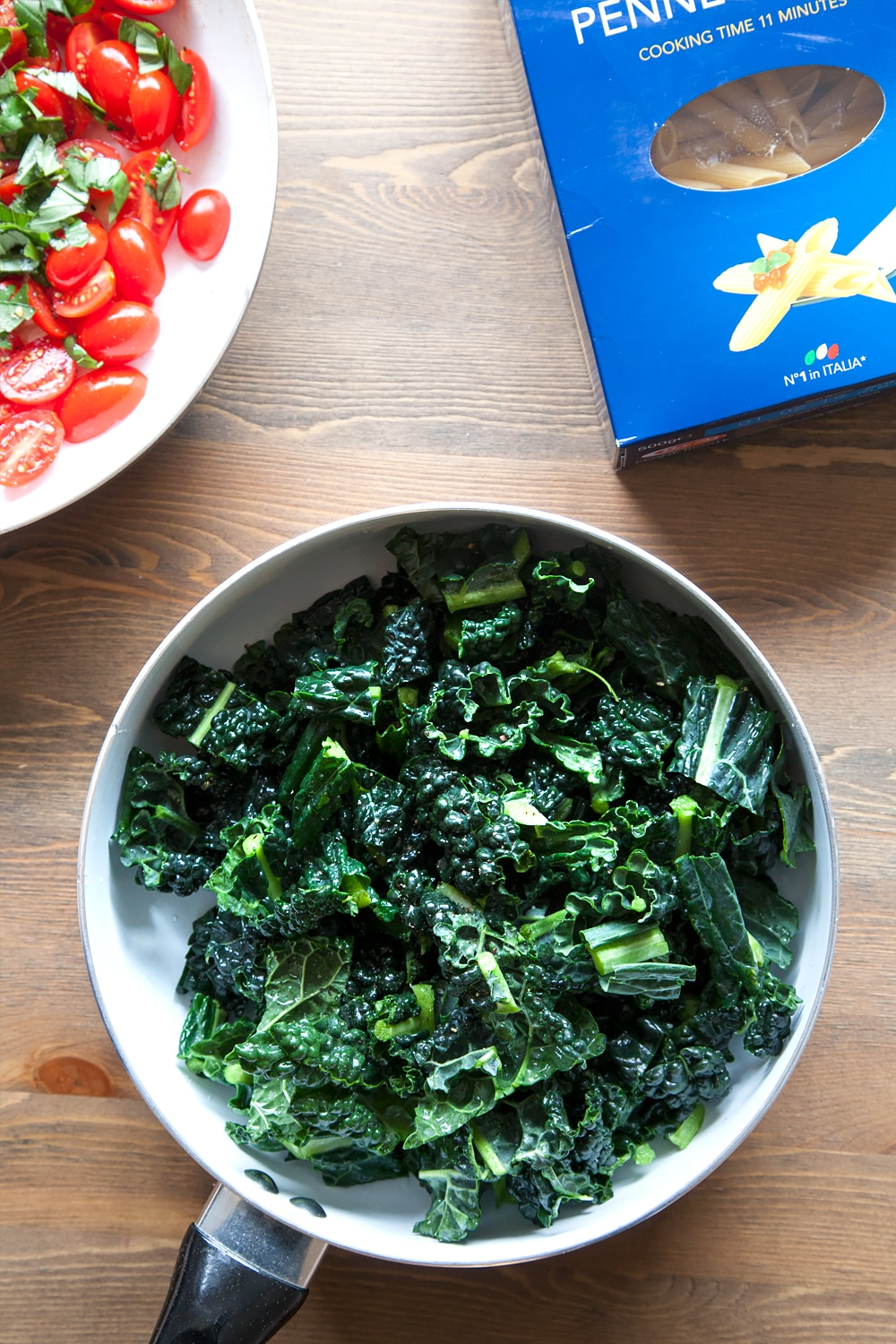 Cavalo nero (black kale) warming in a frying pan