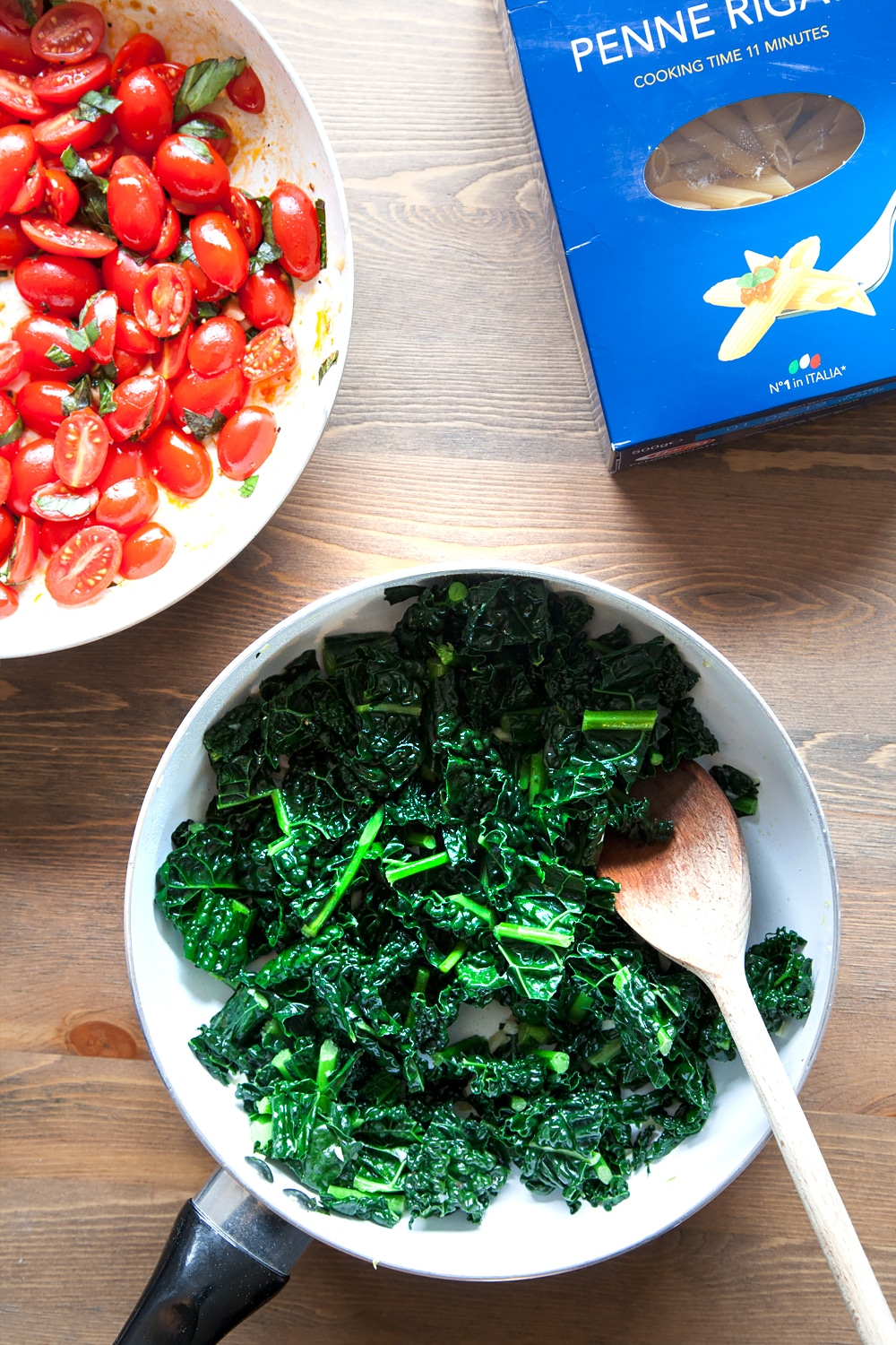 Seasoned wilted cavalo nero (black kale) in a frying pan