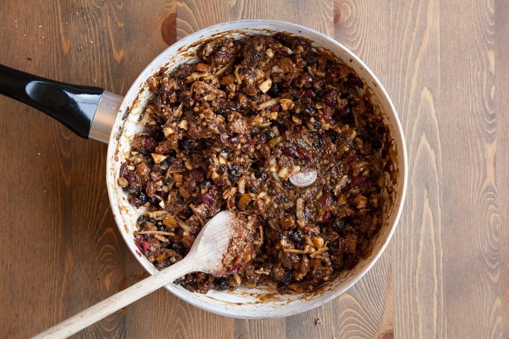 Adding the traditional sixpence to the Christmas pudding mix