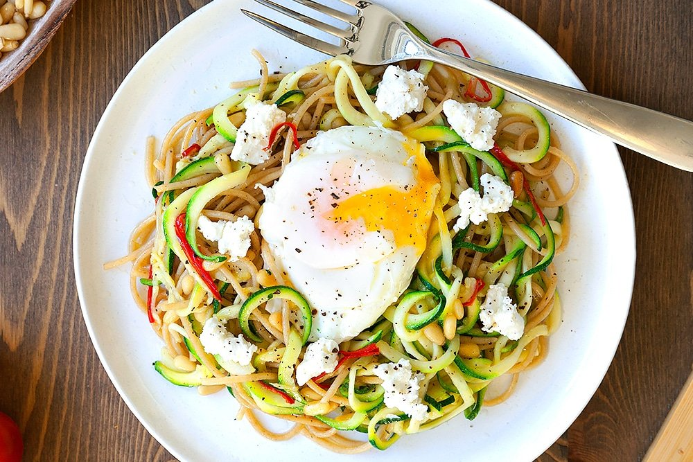 Courgette and whole wheat pasta with poached egg - finished and ready to enjoy!