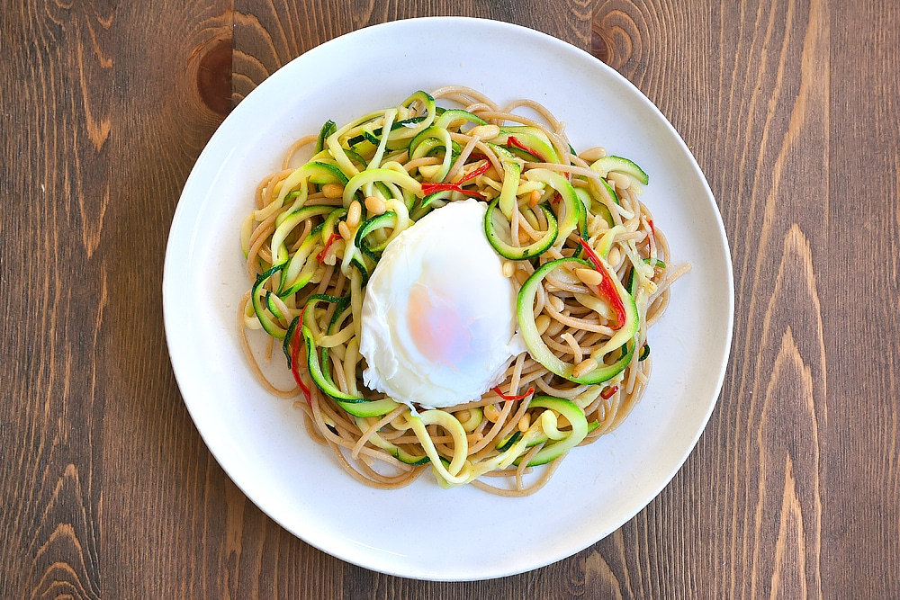 Assemble your courgette and whole wheat pasta, topped with a poached egg
