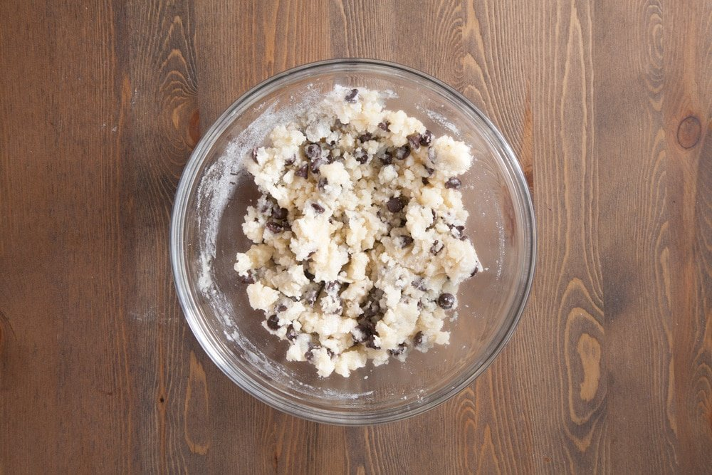 Mixing the ingredients together to create gluten-free chocolate chip cookies